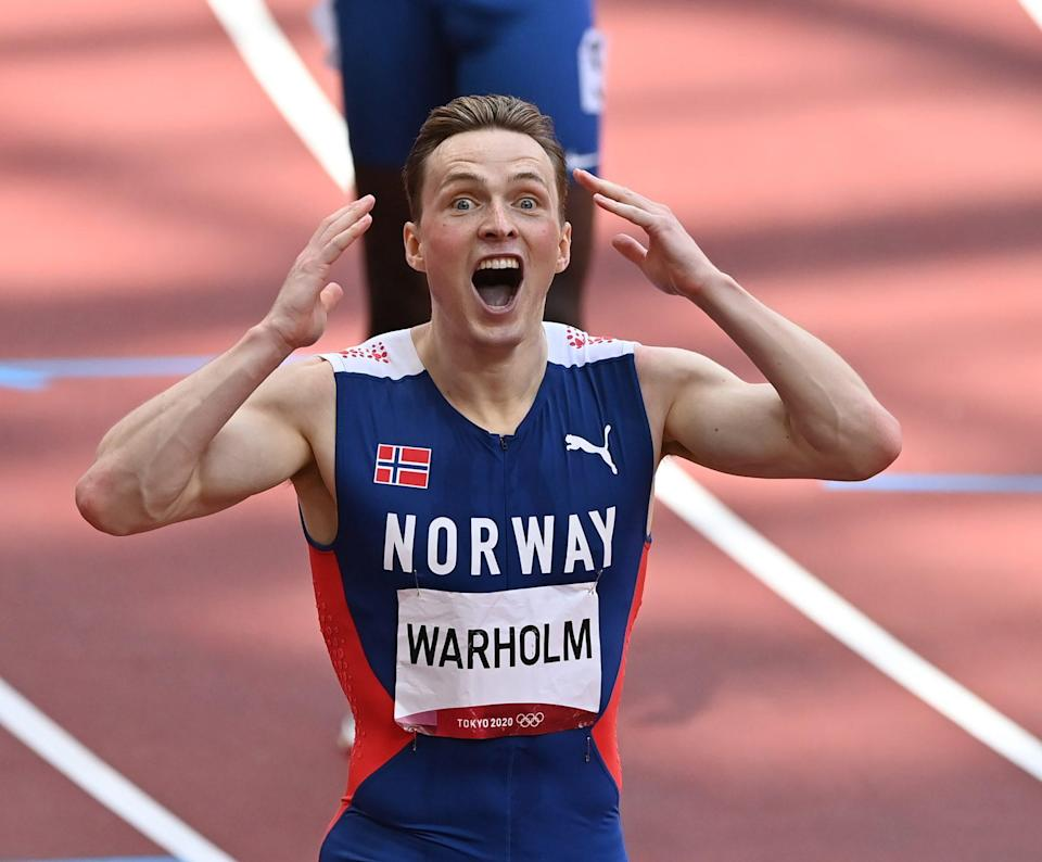 <p>Norway's Karsten Warholm is in disblief after winning the gold medal in the Men's 400m Hurdles Final at Olympic Stadium on August 3.</p>
