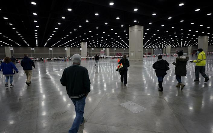 Voters arrive to cast their ballots at the Kentucky Exposition Center during the election in Louisville, Kentucky - REUTERS