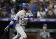 Los Angeles Dodgers' Gavin Lux follows the flight of his RBI-double off Colorado Rockies starting pitcher German Marquez in the fourth inning of a baseball game Wednesday, Sept. 22, 2021, in Denver. (AP Photo/David Zalubowski)