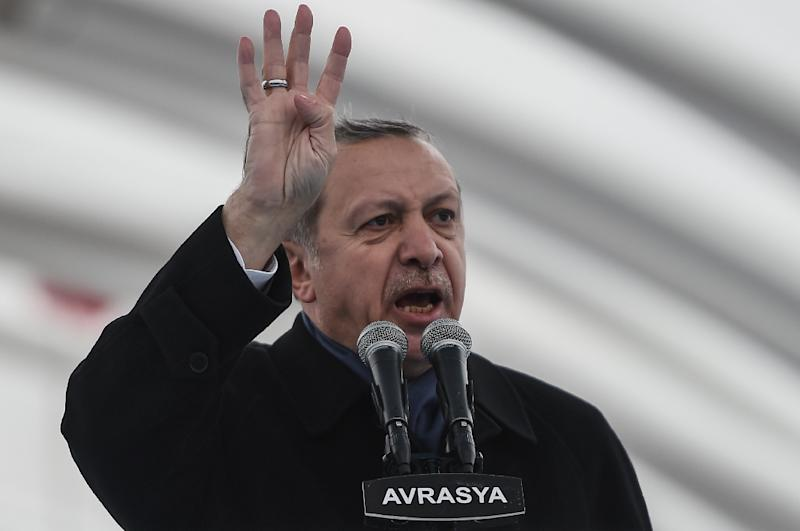 Turkish President Recep Tayyip Erdogan delivers a speech in Istanbul, during the opening cerenomy of the Avrasya (Eurasia) Tunnel, on December 20, 2016
