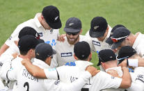 New Zealand's Captain Kane Williamson, center, talks to his players ahead of play against the West Indies on day three of their first cricket test in Hamilton, New Zealand, Saturday, Dec. 5, 2020. (Andrew Cornaga/Photosport via AP)