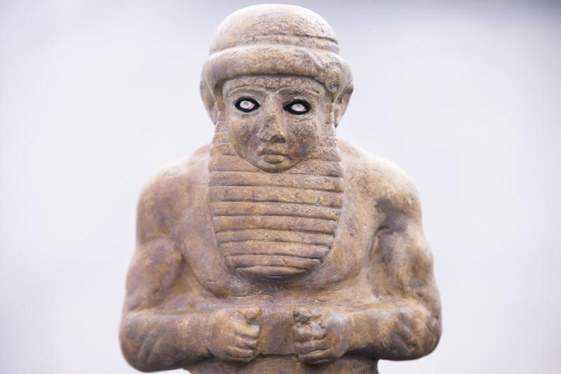Fragment of a figurine of a ruler, 3500 - 3300 BC is displayed at the exhibition ' Uruk 5,000 Years of the Megacity' at the Pergamon Museum Berlin, Wednesday, April 24, 2013. Berlin's Pergamon Museum is offering visitors a glimpse of perhaps the world's first real metropolis in a new exhibition that traces the long history of Uruk, in present-day Iraq. The show marks a century of excavations at Uruk. But even now, organizers say that only about 4.5 percent of the sprawling site in the Iraqi desert has been explored. (AP Photo/Markus Schreiber)