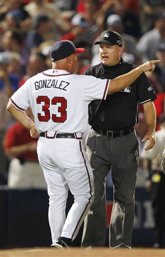 Braves manager Fredi Gonzalez argues the infield-fly rule call during the eighth inning. (AP)