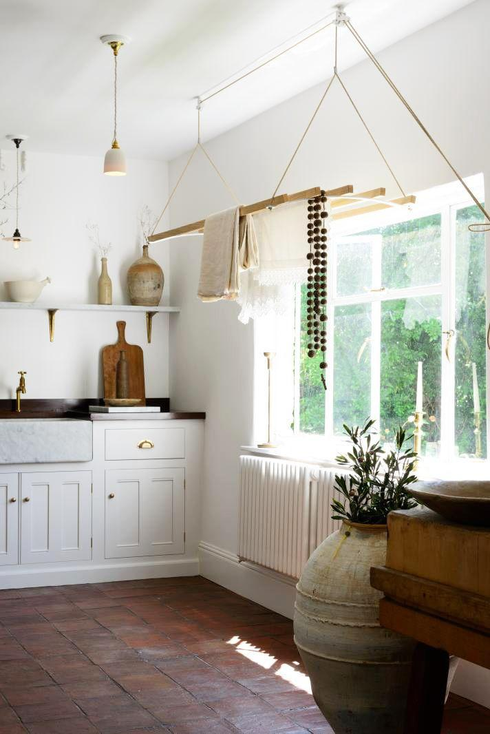 <p>Though most of us don't love the look of old heating furnaces in the kitchen, there's not a great alternative. Draw the eye upward with a hanging structure as done here in this deVOL kitchen. Whether you display wind chimes or hang your linens here, it'll come in handy beyond it's aesthetic value. </p>