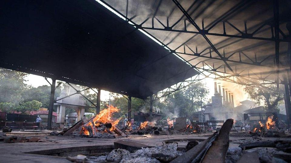 Multiple burning pyres of patients who died of the Covid-19 coronavirus infections at a crematorium on 17 April 2021 in Delhi, India