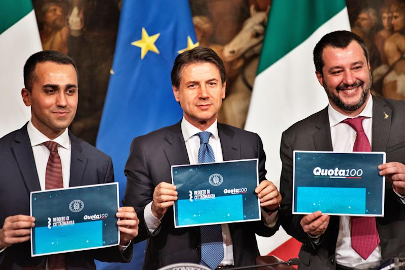 (From L) Italy's Deputy Prime Minister and Minister of Economic Development, Labour and Social Policies, Luigi Di Maio, Italy's Prime Minister, Giuseppe Conte, Italy's Deputy Prime Minister and Interior Minister, Matteo Salvini, hold banners of the new laws during a press conference at Palazzo Chigi in Rome, Italy, following a Cabinet meeting on citizens basic income law and 'quota 100' retirement reform in Rome, Italy, on January 17, 2019. (Photo by Michele Spatari/NurPhoto via Getty Images) (Photo: NurPhoto via Getty Images)
