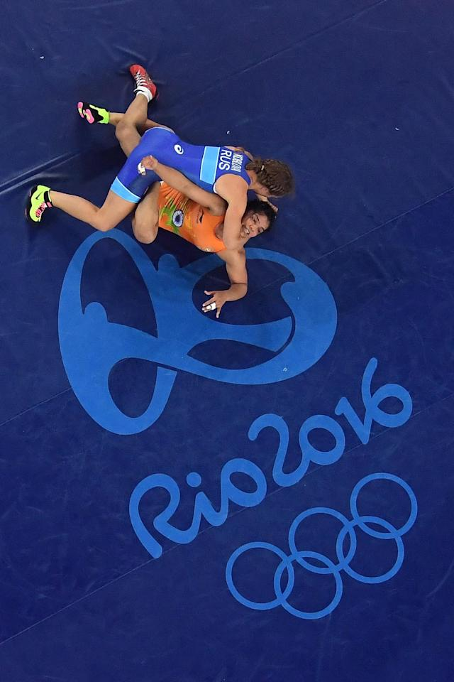 <p>Sakshi Malik (bottom) of India competes against Valeriia Koblova Zholobova of Russia during a Women's Freestyle 58kg Quarterfinal bout on Day 12 of the Rio 2016 Olympic Games at Caioca Arena 2 on August 17, 2016 in Rio de Janeiro, Brazil. (Photo by Lars Baron/Getty Images) </p>