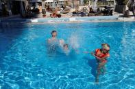 Zane Scotland plays with his family at the swimming pool, amid the spread of the coronavirus disease (COVID-19) in Dubai