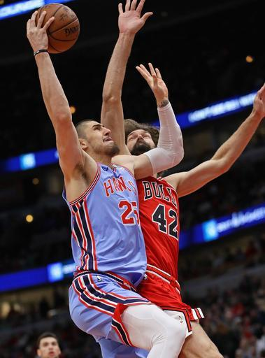 CHICAGO, ILLINOIS - MARCH 03: Alex Len #25 of the Atlanta Hawks goes up for a shot against Robin Lopez #42 of the Chicago Bulls on his way to a game-high 28 points at the United Center on March 03, 2019 in Chicago, Illinois. (Photo by Jonathan Daniel/Getty Images)