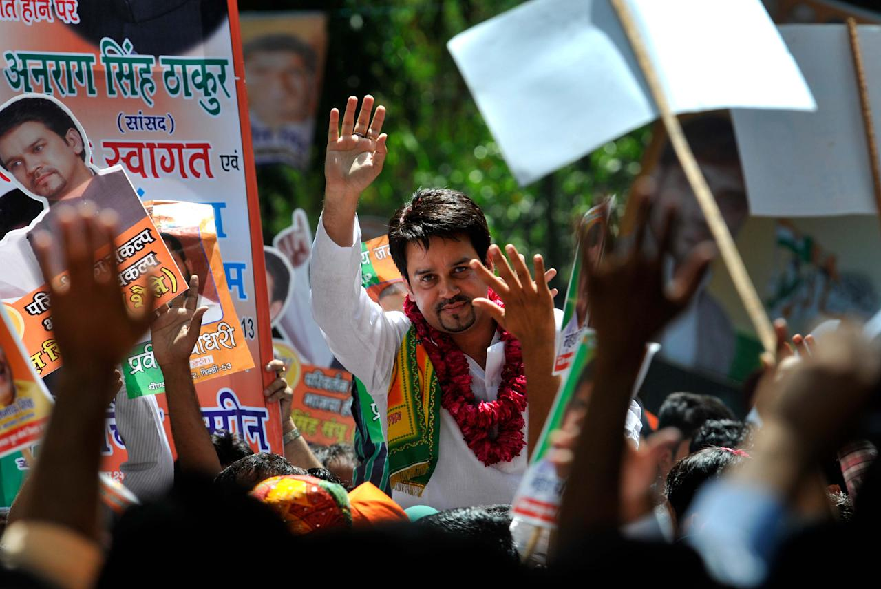 NEW DELHI, INDIA - APRIL 19: Bharatiya Janata Yuva Morcha (BJYM) activists greets Anurag Thakur as he has been re-elected as President of BJYM for the second time at BJP office on April 19, 2013 in New Delhi, India. Thakur, son of Himachal Pradesh Chief Minister Prem Kumar Dhumal, gave the slogan of ?struggle, service and sacrifice? to his BJYM colleagues. (Photo by Arijit Sen/Hindustan Times via Getty Images)
