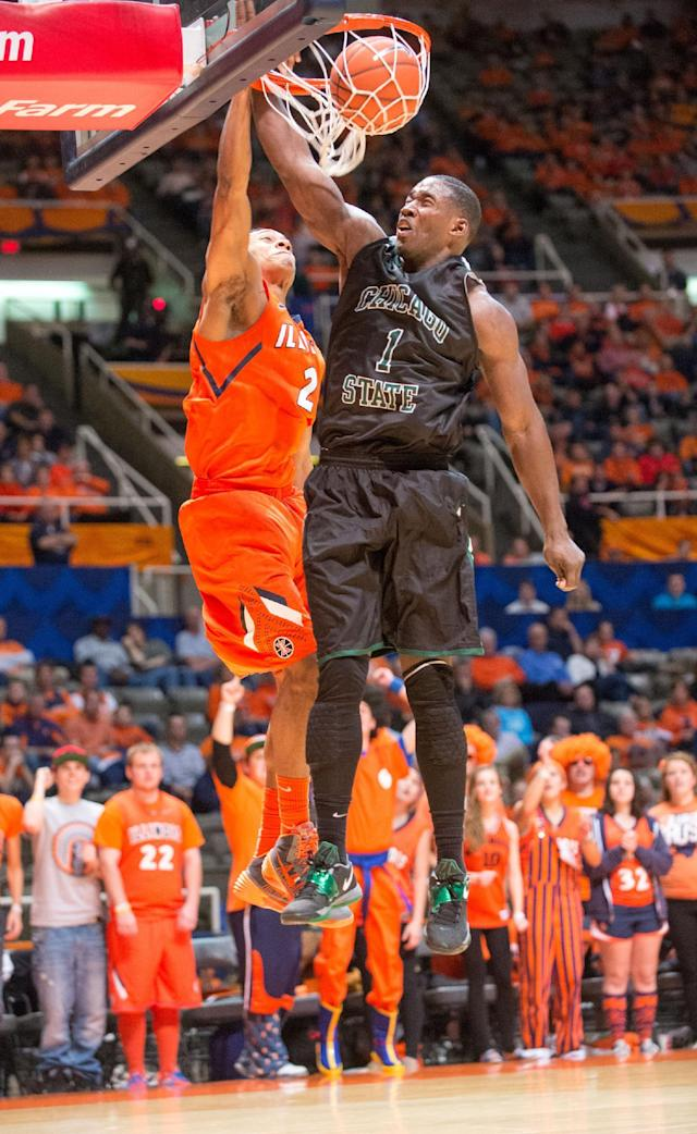 Illinois' Joseph Bertrand (2) gets a basket despite the efforts of Chicago State's Eddie Denard (1)during the second half of an NCAA college basketball game on Friday, Nov. 22, 2013, in Champaign, Ill. Illinois defeated Chicago State 77-53. (AP Photo/Darrell Hoemann)