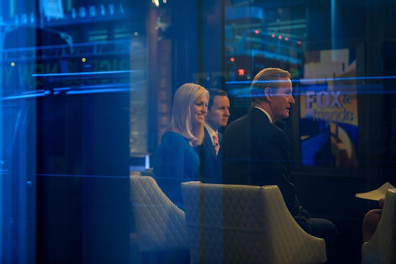 Seen through a window, hosts Brian Kilmeade, Ainsley Earhardt, and Steve Doocy broadcast 'Fox And Friends' from the Fox News studios: Getty Images