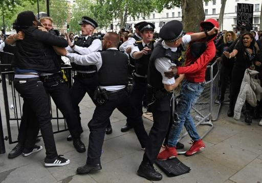 Protesters scuffle with police on Downing Street during an anti-racism demonstration
