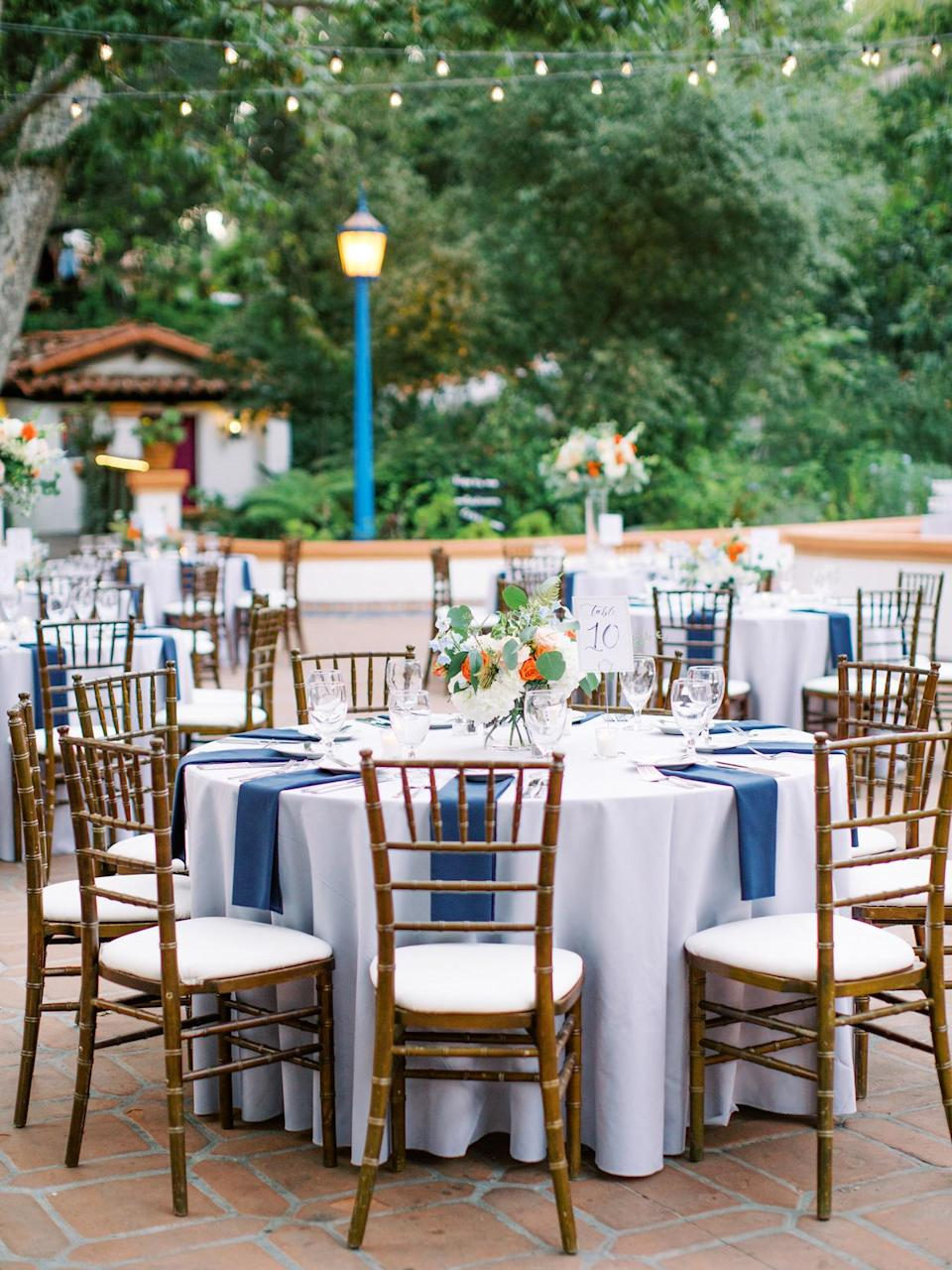 <p>Charles and Ana's attendees sat in front of them, at round tables which were covered with silver linens and punctuated with blue napkins.</p>