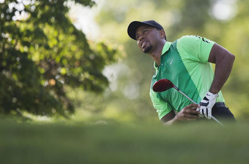 US golfer Tiger Woods reacts after teeing off during the first round of the Quicken Loans National at Congressional Country Club in Bethesda, Maryland, June 26, 2014
