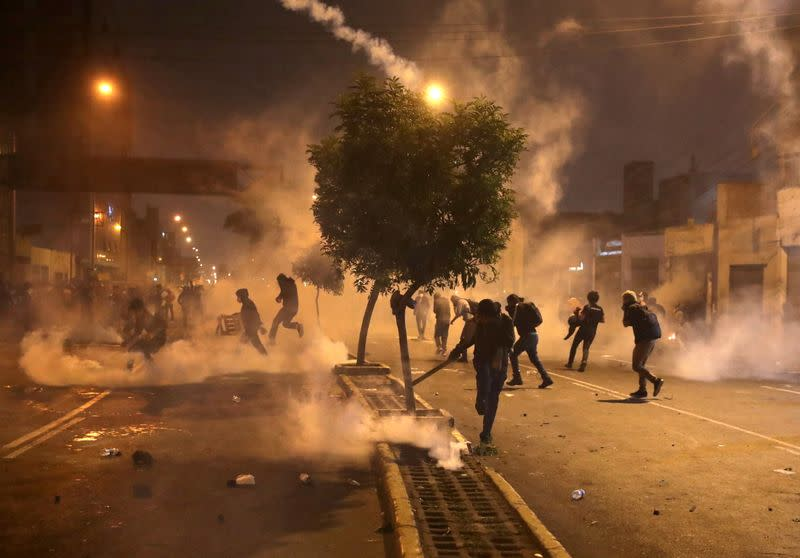 Demonstrators clash with police during protests following the impeachment of President Martin Vizcarra, in Lima
