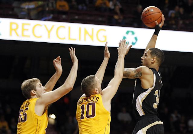 Wofford forward Lee Skinner, right, goes to the basket against Minnesota forward Oto Osenieks (10) and center Elliott Eliason (55) in the first half of an NCAA college basketball game Thursday, Nov. 21, 2013, in Minneapolis. (AP Photo/Stacy Bengs)