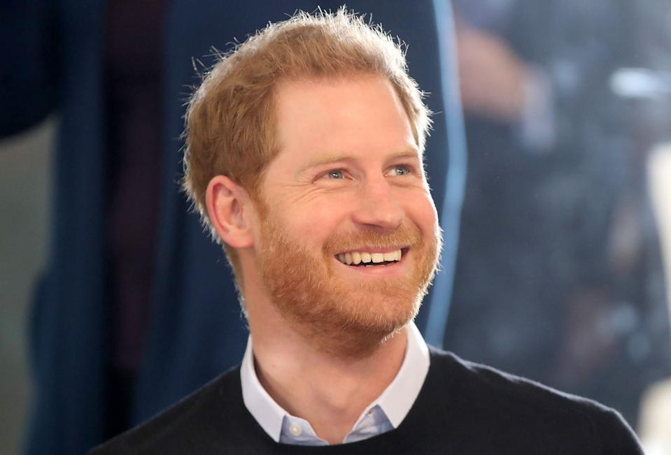 Britain's Prince Harry, Duke of Sussex smiles as he watches a trampolining session during his visit to a Fit and Fed half-term initiative in Streatham, south London on February 19, 2019. - Launched in 2016, Fit and Fed is a campaign led by StreetGames that aims to tackle the holiday gap of hunger, inactivity, and isolation. The project offers activity sessions and a nutritious meal every day for local children. (Photo by Chris Jackson / POOL / AFP)        (Photo credit should read CHRIS JACKSON/AFP via Getty Images)