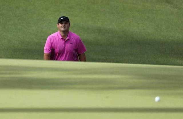 Patrick Reed of the U.S. walks up to his ball on the 10th green during final round play of the 2018 Masters golf tournament at the Augusta National Golf Club in Augusta, Georgia, U.S. April 8, 2018. REUTERS/Lucy Nicholson