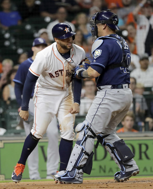 Houston Astros' George Springer, left, is tagged out by Tampa Bay Rays catcher Wilson Ramos (40) while trying to score during the first inning of a baseball game Tuesday, June 19, 2018, in Houston. (AP Photo/David J. Phillip)
