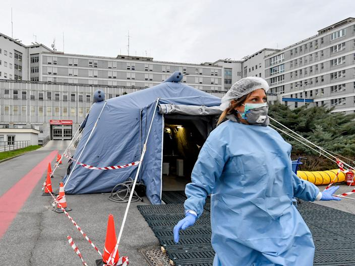 A paramedic walks out of a tent that was set up in front of the emergency ward of the Cremona hospital in northern Italy.