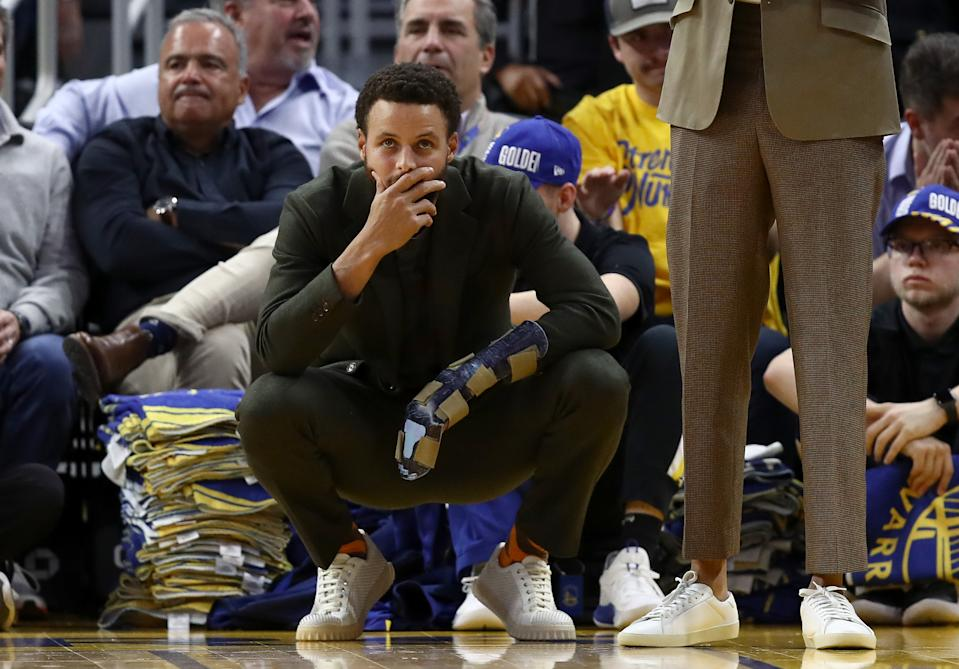 SAN FRANCISCO, CALIFORNIA - NOVEMBER 25:  Injured Stephen Curry #30 of the Golden State Warriors watches the final seconds of their loss to the Oklahoma City Thunder at Chase Center on November 25, 2019 in San Francisco, California.  NOTE TO USER: User expressly acknowledges and agrees that, by downloading and or using this photograph, User is consenting to the terms and conditions of the Getty Images License Agreement. (Photo by Ezra Shaw/Getty Images)