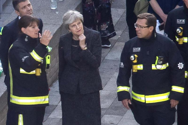 Commissioner Cotton speaks to then Prime Minister Theresa May at the site of the Grenfell Tower disaster (Getty Images)