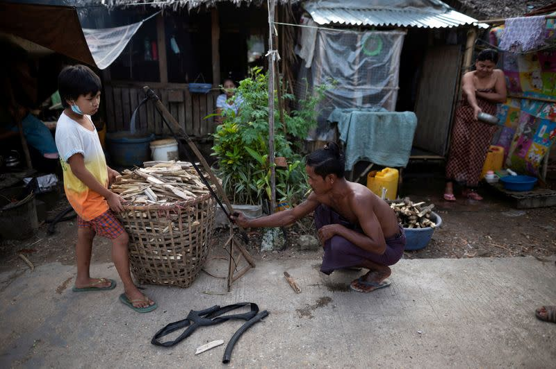 Man prepares trap to catch rats for food during a coronavirus lockdown in Yangon