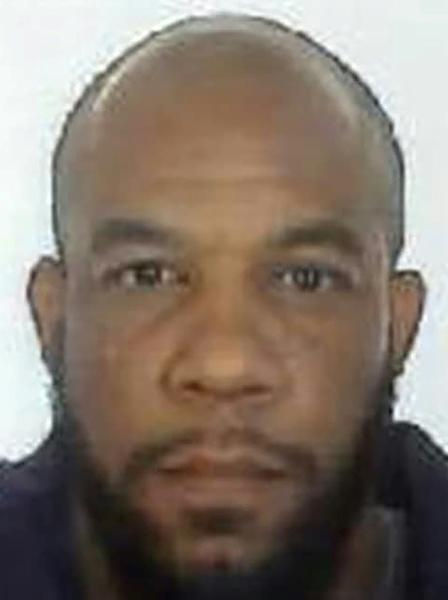 Khalid Masood, seen here in a passport-style photo released by police, used multiple aliases including the names Adrian Elms and Adrian Russell Ajao
