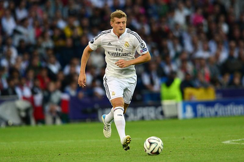 Real Madrid's Toni Kroos runs with the ball during their UEFA Super Cup match against Sevilla, at Cardiff City Stadium in Wales, on August 12, 2014 (AFP Photo/Carl Court)