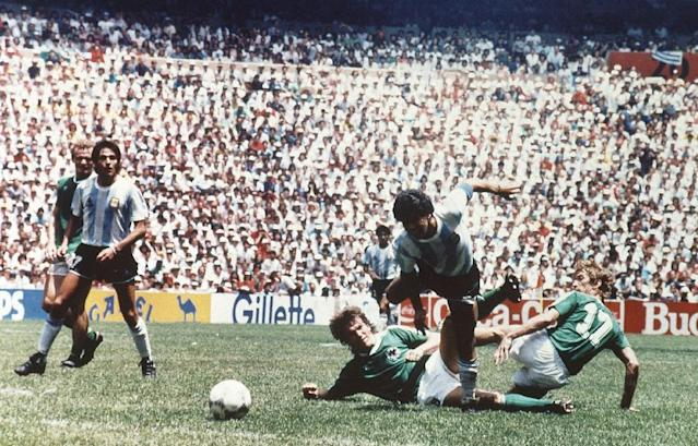 FILE - The June 29, 1986 file photo shows Argentina's Diego Maradona dribbling past West German players during the World Cup Soccer Final match between Argentina and West Germany at Azteca Stadium in Mexico City, Mexico. On Sunday, July 13, 2014, Germany and Argentina will face each other again in the final of the 2014 soccer World Cup. (AP Photo/file)