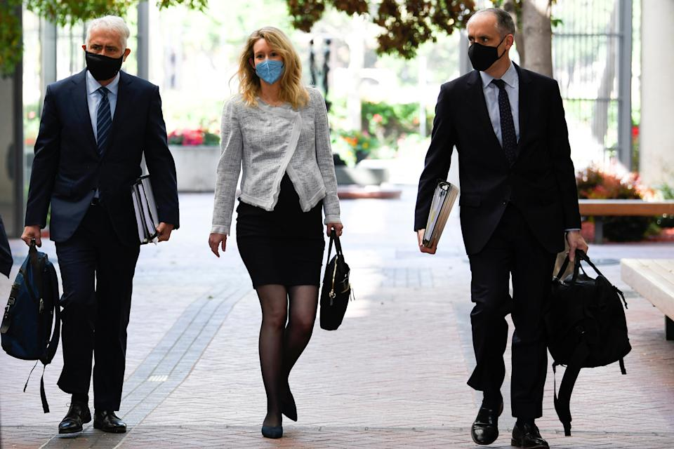 Theranos founder Elizabeth Holmes arrives at the Robert F. Peckham Federal Building to attend a federal court hearing in San Jose, California, U.S. May 4, 2021.  REUTERS/Kate Munsch