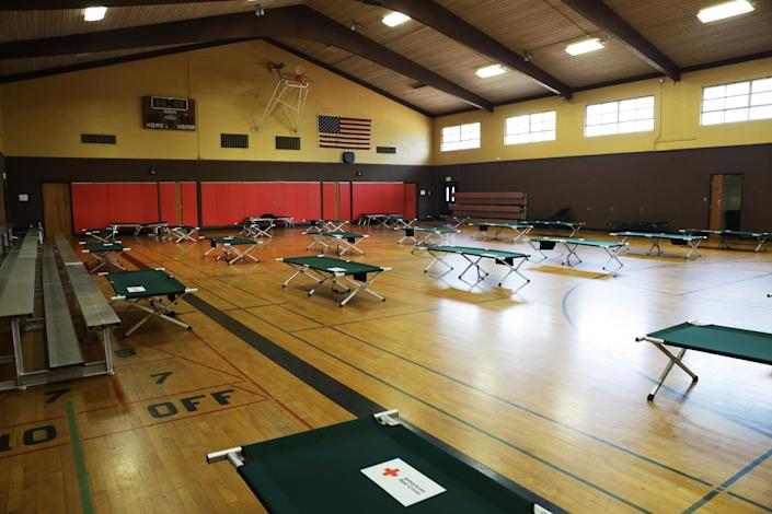 Cots are spread out in Crosswalk Community Church in Napa, Calif., on Aug. 24, 2020. (Chiara Sottile / NBC News)