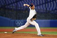 <p>YOKOHAMA, JAPAN - AUGUST 02: Yudai Ohno #22 of Team Japan pitches in the ninth inning against Team United States during the knockout stage of men's baseball on day ten of the Tokyo 2020 Olympic Games at Yokohama Baseball Stadium on August 02, 2021 in Yokohama, Kanagawa, Japan. (Photo by Yuichi Masuda/Getty Images)</p>