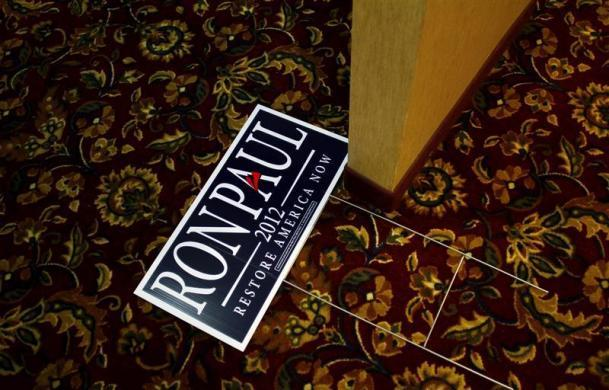 A campaign sign for Ron Paul is seen before a town hall meeting in Ft. Madison, Iowa December 21, 2011. (REUTERS/Joshua Lott)