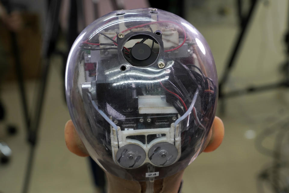 The head of Sophia shows the inside content visually through the transparent skull at Hanson Robotics studio in Hong Kong on March 29, 2021. Sophia is a robot of many talents — she speaks, jokes, sings and even makes art. In March, she caused a stir in the art world when a digital work she created as part of a collaboration was sold at an auction for $688,888 in the form of a non-fungible token (NFT). (AP Photo/Vincent Yu)