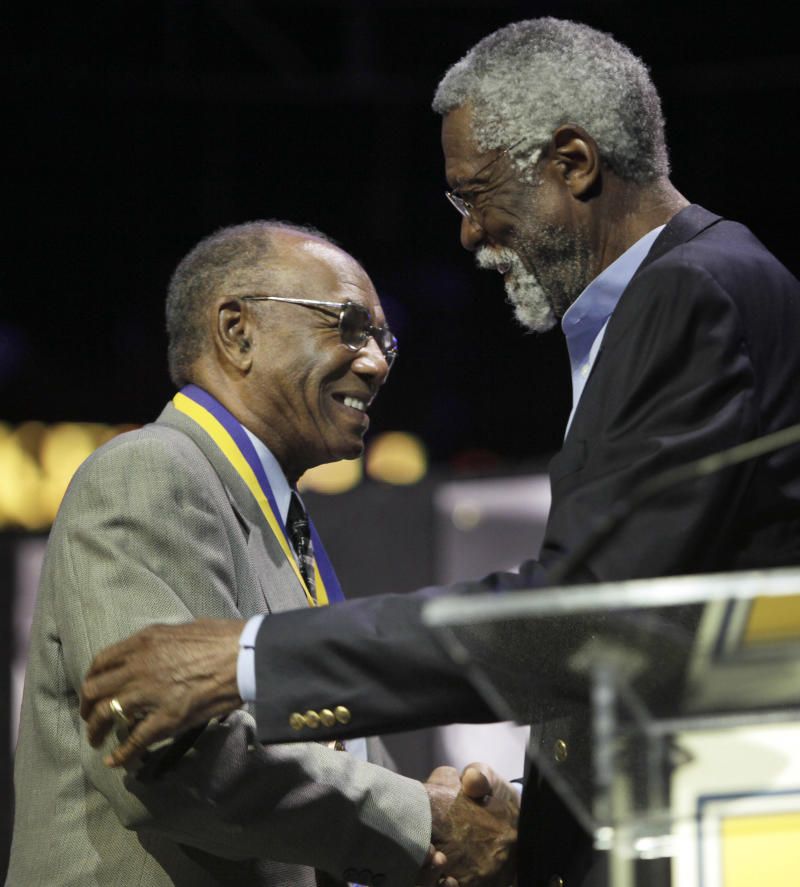 Former Boston Celtics player Sam Jones, left, is presented with a Lifetime Achievement Award by former Celtics player Bill Russell at The Sports Museum's annual The Tradition fundraiser and awards ceremony, in Boston, Wednesday, June 24, 2009. (AP Photo/Steven Senne)