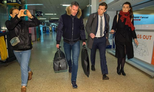 Jamie Carragher (second left) arrives at Euston train station.