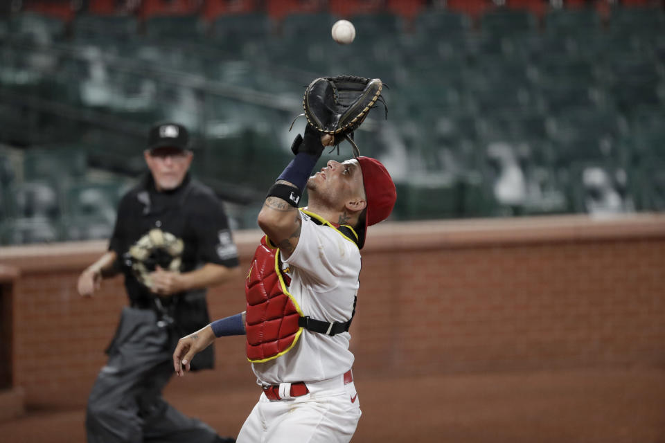 St. Louis Cardinals catcher Yadier Molina catches a popup by Pittsburgh Pirates' Kevin Newman for an out during the eighth inning of a baseball game Friday, July 24, 2020, in St. Louis. (AP Photo/Jeff Roberson)