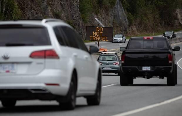 A Do Not Travel sign sits on the median of the Sea-to-Sky Highway between Horseshoe Bay and Lions Bay, B.C., on April 23. Non-essential travel remains restricted between three regional zones in British Columbia. (The Canadian Press/Darryl Dyck - image credit)