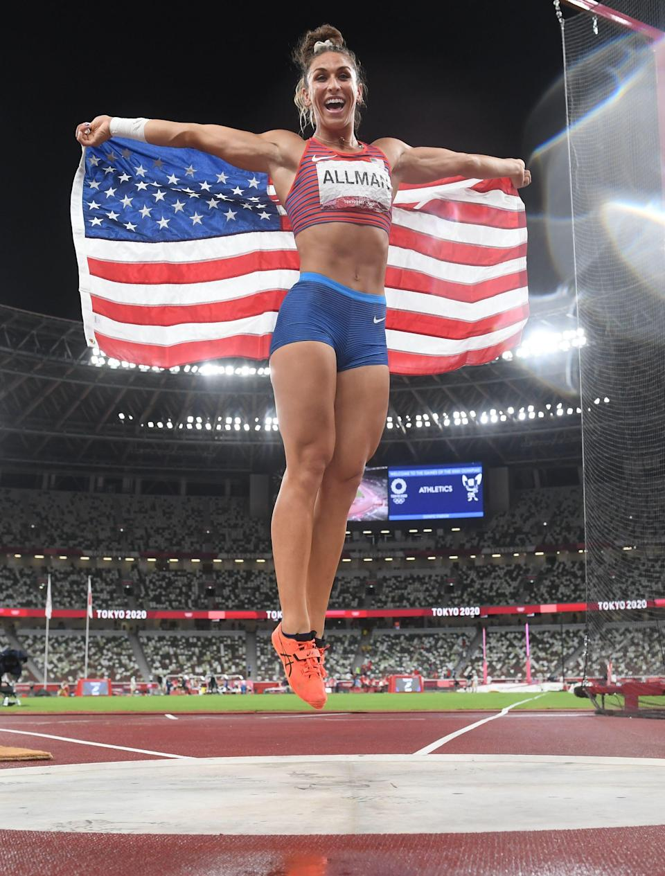 Valarie Allman celebrated after winning the discus gold.