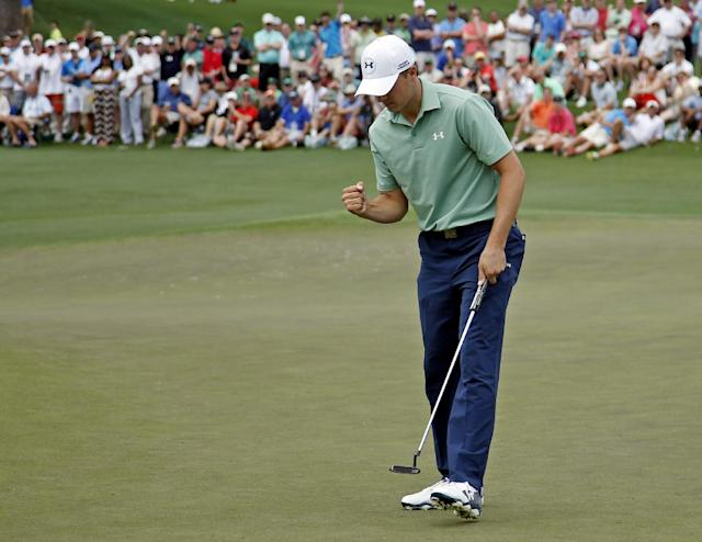 Jordan Spieth pumps his fist after a birdie putt on the second hole during the fourth round of the Masters golf tournament Sunday, April 13, 2014, in Augusta, Ga. (AP Photo/Matt Slocum)