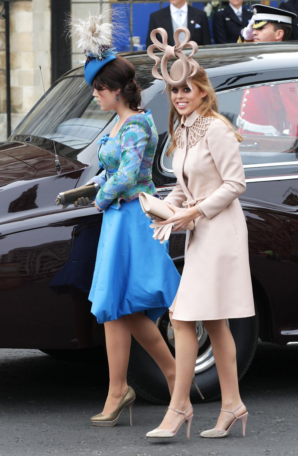 Princess Beatrice and Princess Eugenie attend Wills and Kate's royal wedding in famously bad fascinators and dresses