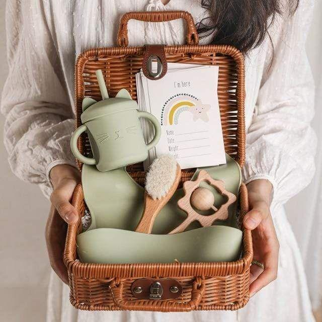 """<p><strong>Momorii</strong></p><p>momorii.com</p><p><strong>$79.95</strong></p><p><a href=""""https://momorii.com/products/vintage-baby-gift-set?variant=40495372861618¤cy=USD&gclid=CjwKCAjw95yJBhAgEiwAmRrutMgOBAgAAuDjeLRSiSd3yiJ70kNm4dCQcI3YdmE-1k9sTGbiyJFqWxoCaOIQAvD_BwE"""" rel=""""nofollow noopener"""" target=""""_blank"""" data-ylk=""""slk:Shop Now"""" class=""""link rapid-noclick-resp"""">Shop Now</a></p><p>If there's any type of gift a new mother loves, it's one that her bb will adore. How can you not have heart-eyes over the sleek utensils, the stacking rings game, and the assortment of milestone cards?!</p>"""