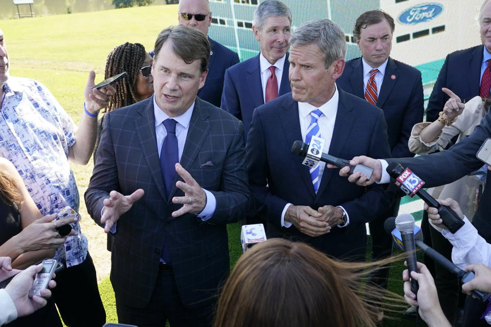 Jim Farley, Ford president and CEO, center left, along with Tennessee Gov. Bill Lee, center right, answers questions along with after a presentation on the planned factory to build electric F-Series trucks and the batteries to power future electric Ford and Lincoln vehicles Tuesday, Sept. 28, 2021, in Memphis, Tenn. The plant in Tennessee is to be built near Stanton, Tenn. (AP Photo/Mark Humphrey)
