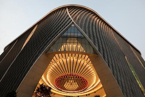 The Xiqu Centre in Tsim Sha Tsui draws its design from traditional Chinese lanterns, with its undulating exterior covered in a weave of aluminium panels. Photo: Felix Wong