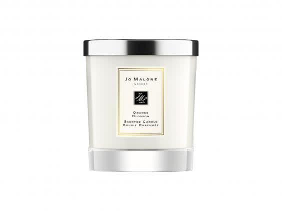 Light a scented candle and switch off from your to-do list before you start your facial (Jo Malone London)