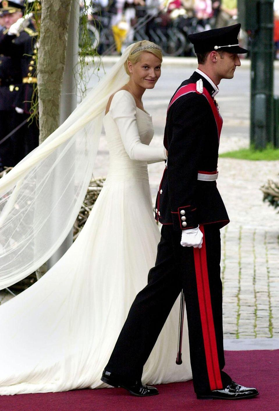 "<p>Mette-Marit Tjessem Hoiby met The Crown Prince Haakon of Norway during a party at the Quart Festival, Norway's largest music festival. The two later met again and started dating, and were married in 2001. </p><p>Prior to becoming Norwegian royalty, Mette-Marit was a waitress and a single mother, <a href=""https://www.marieclaire.com/culture/g14448603/royal-wedding-dresses-through-the-years/?slide=29"" rel=""nofollow noopener"" target=""_blank"" data-ylk=""slk:reports Marie Claire"" class=""link rapid-noclick-resp"">reports <em>Marie Claire</em></a>, making this meeting a real life Cinderella story.</p>"