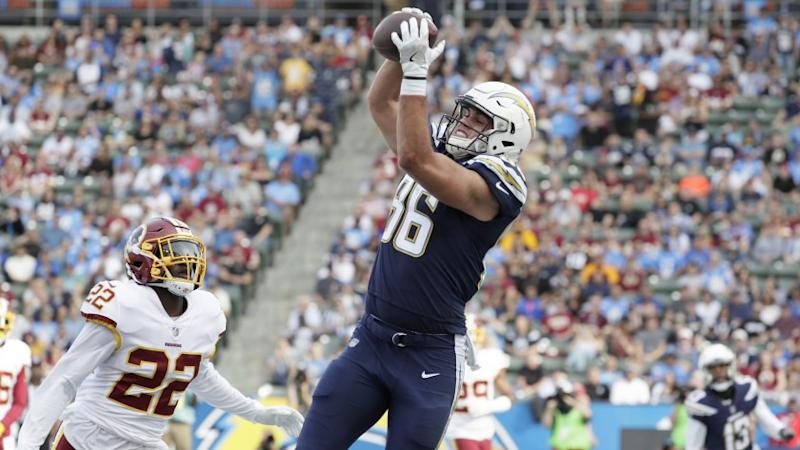 Chargers tight end Hunter Henry hauls in a touchdown pass over Redskins safety Deshazor Everett during the first quarter.