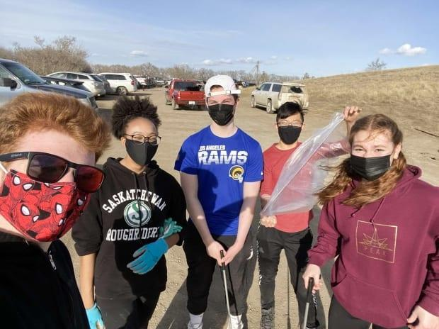 Sophia Lacroix (second from the left) and Kai Chen (second from the right) are seen this spring gathering plastic bottles with friends. The pair started SK Eco Solutions, a non-profit they hope will provide the raw material needed by 3D printers.  (Submitted by Kai Chen  - image credit)